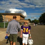 Jon walking off football field